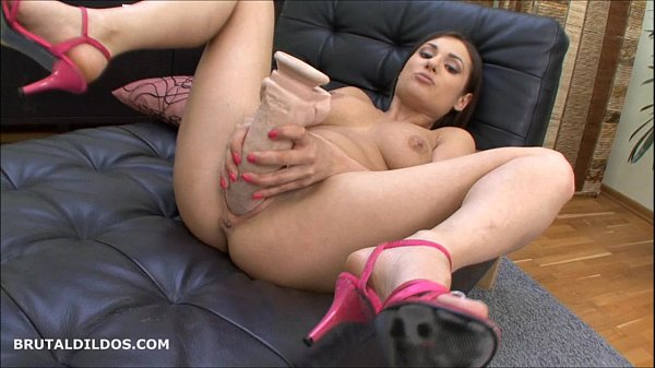 Cute brunette fills her pussy with a b. dildo