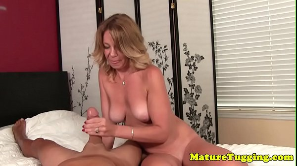 Beautiful mature tugging hard cock