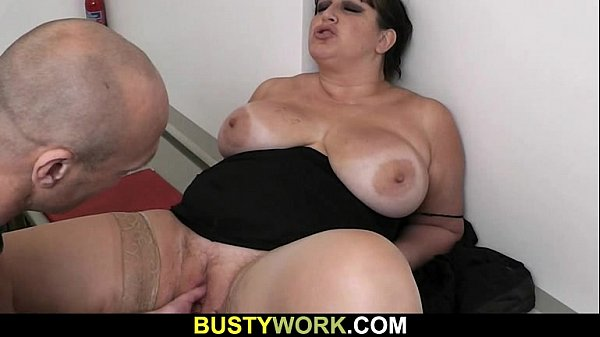 Busty bitch in pantyhose rides his dick at work