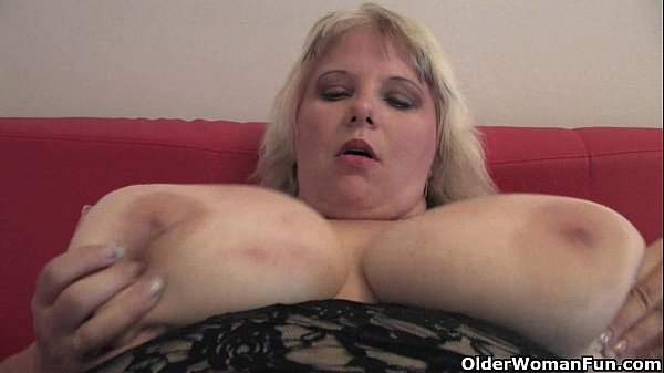 Oversized mom with huge tits finger fucks her mature pussy
