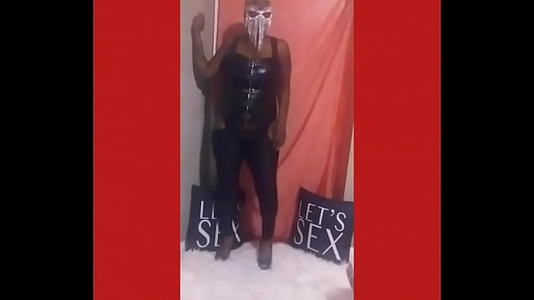 Dancing in crotchless pants and silver chain mask Thumb