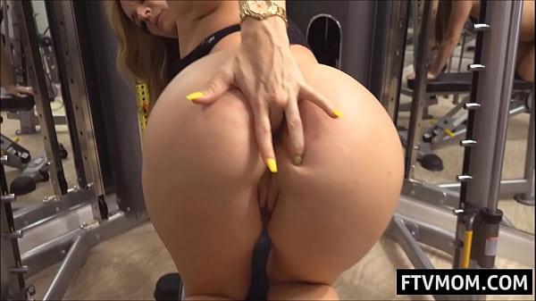 milf masturbates in the gym