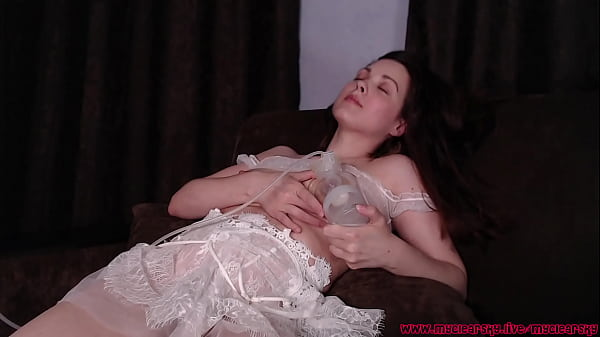 Brunette babe drinking her own milk and pump tits