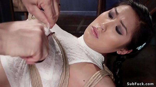 Busty Asian butt plugged in hogtie