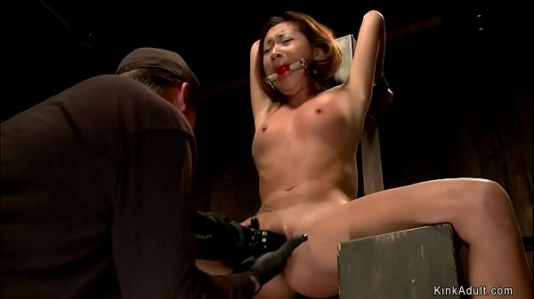 Petite Asian in bdsm throne fingered Thumb