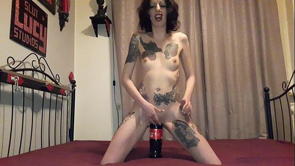 Slut Lucy rides a huge coke bottle