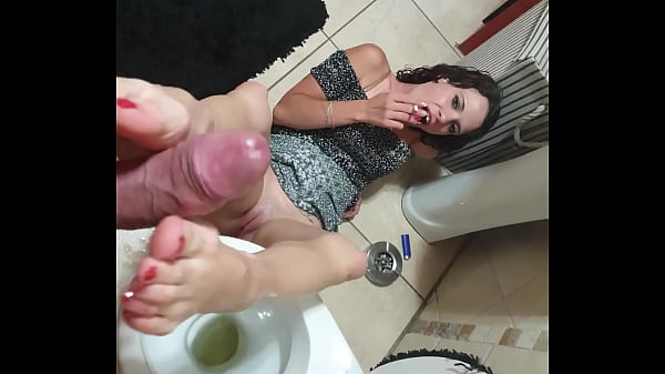 Tiny slut giving the cock a wet footjob after her feet were soaked in piss | smoking