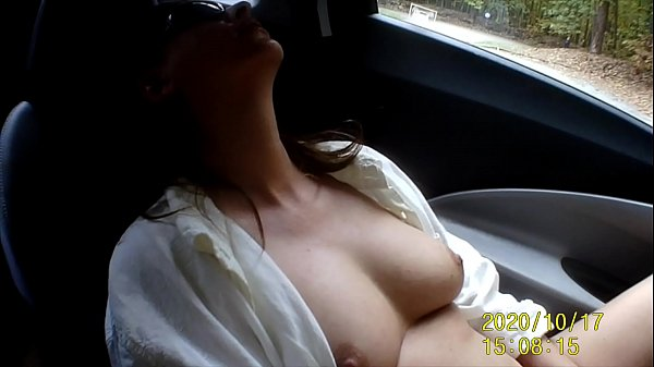 I'm masturbating with my dildo naked in my car