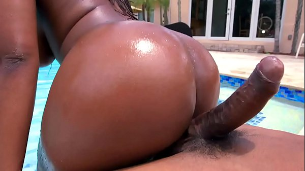 Hot black babe gets horny at the pool and starts sucking a big black dick