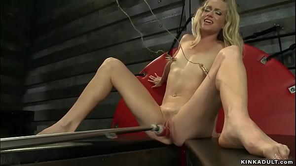 Long legged blonde squirter on machine