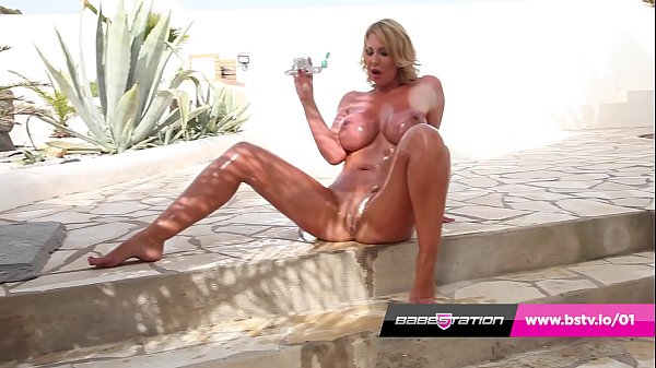 Hot UK MILF Leigh Darby oils up and plays with her pussy