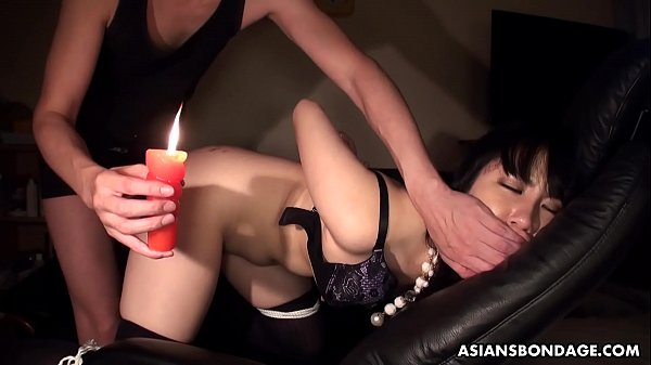 Pouring hot candle and oil on her ass as she's fucked