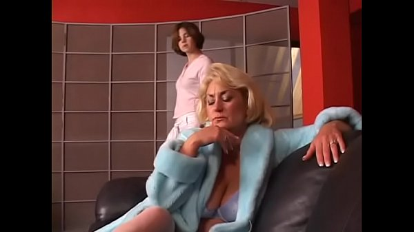 Young brunette with perky tits gets her shaved pussy eaten by older lady