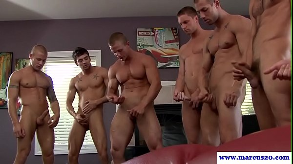 Muscular hung hunk cum showered in orgy