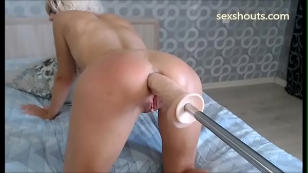 Fantastic Blonde spanking her big ass and pussy with a Fucking Machine
