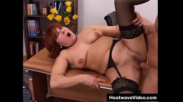 This old whore's saggy tits bounce with every thrust as she gets fucked hard on the office table