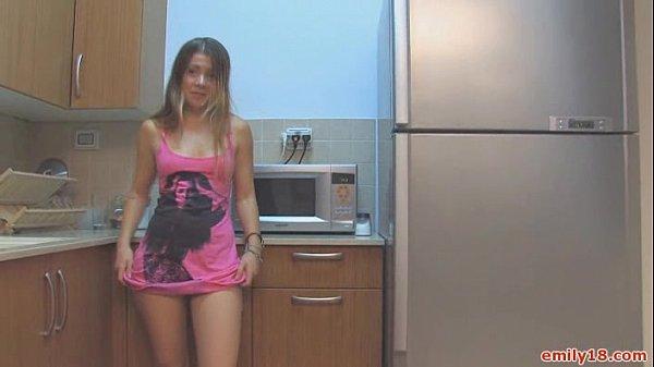 Teen in sneakers in kitchen