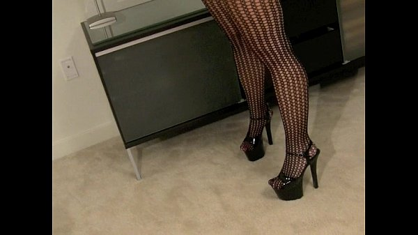 Hot Blonde Chick Strips out of her Black Fishnets