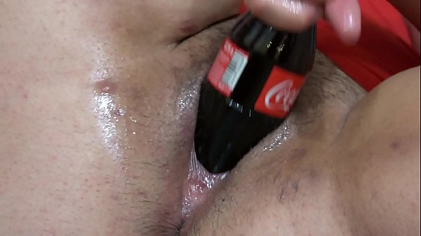 Fat lesbian in a gymnastic pose, and a girlfriend with a big dildo fucks her hairy pussy. And masturbation with a bottle of Coca-Cola. Fetish with a deep, wide hole in a thick cunt