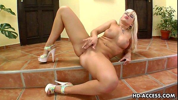 Big tit blonde Cindy uses a glass dildo