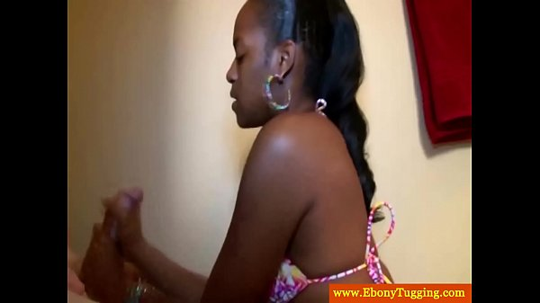 Hot ebony beautie jerking white cock