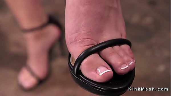 Babe in bondage gets feet tormented