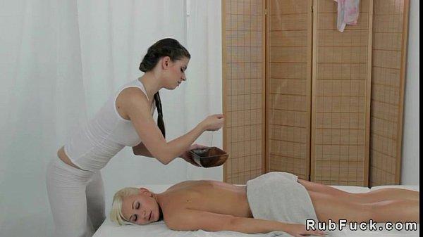 Beautiful blonde laying and getting lesbian massage