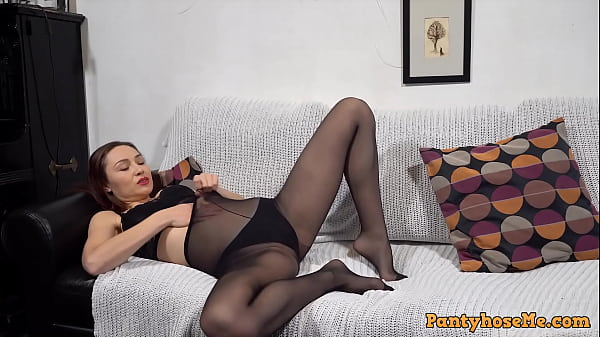 Sexy Long Hair Slut In Black Bra, Panties and Pantyhose Teasing On The Couch