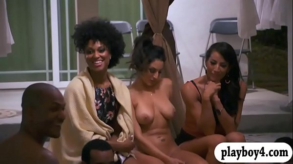 Group of sexy cougars enjoying horny men by the pool
