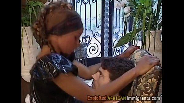 Beautiful African maid in latex sucks off her white master