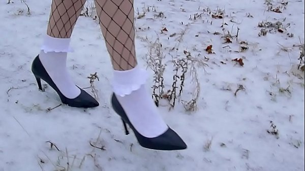 High heels and white frilly socks in the snow