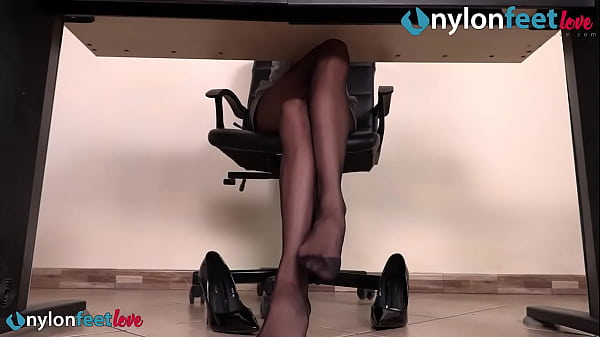 Secretary under the desk shoeplay and feet in stockings Thumb