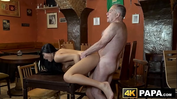 Naughty vixen seduces and rides old mans dick in a bar