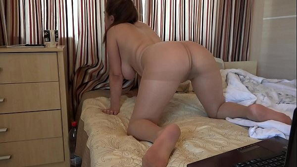 Busty babe with a juicy ass in nylon pantyhose masturbates her hairy pussy in front of a webcam. Homemade foot fetish and fetish