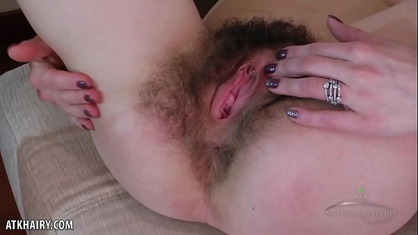 Liza James dances and fingers her hairy pussy