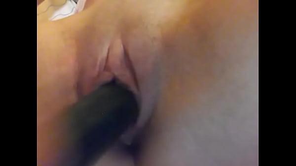 Teen girl masturbating with cucumber