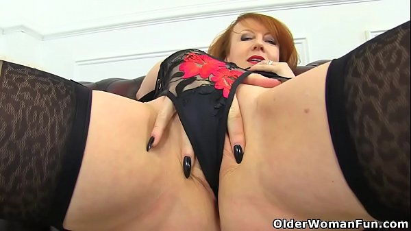 English milf Red probes her fanny with two fingers