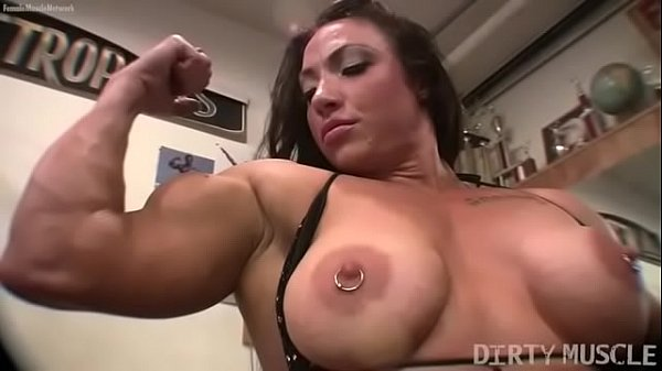 Female bodybuilder BrandiMae works her biceps and pussy in the gym