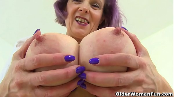 English milf Tigger plays with her big tits and...
