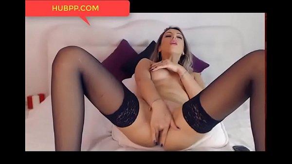 Hot blonde slut in black stockings squirts on her feet, nice legs