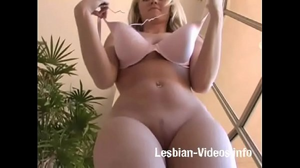Blonde girl changing her bra and jumping in topless Thumb