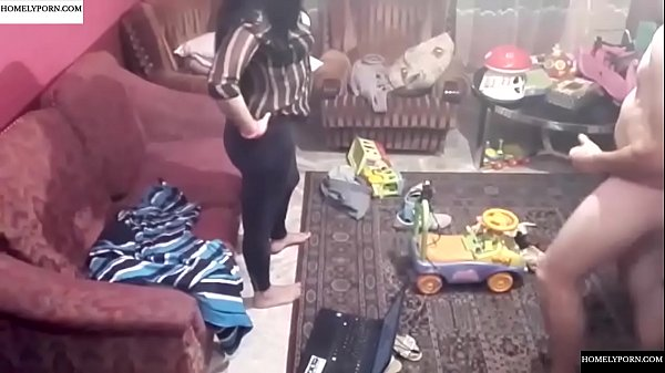 Spy camera records couple fucking in the living...