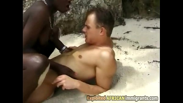 Booty ebony gets stretched riding white dick at the beach