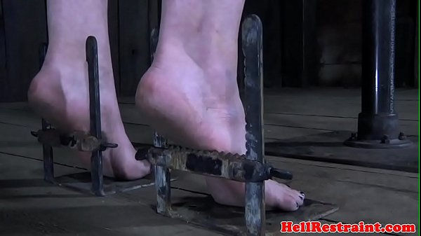 Spreadeagle bdsm sub has feet oiled