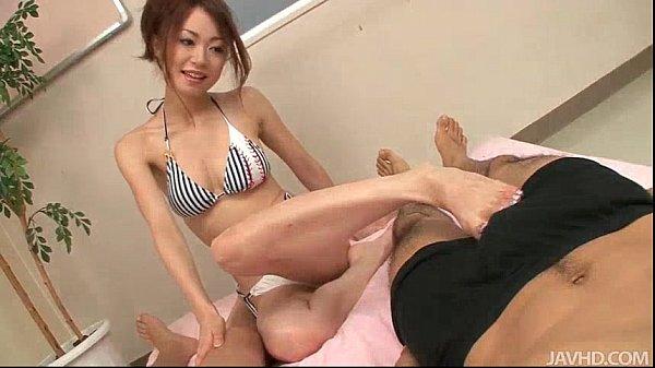 Sara Seori uses her pretty feet to fondle two cocks