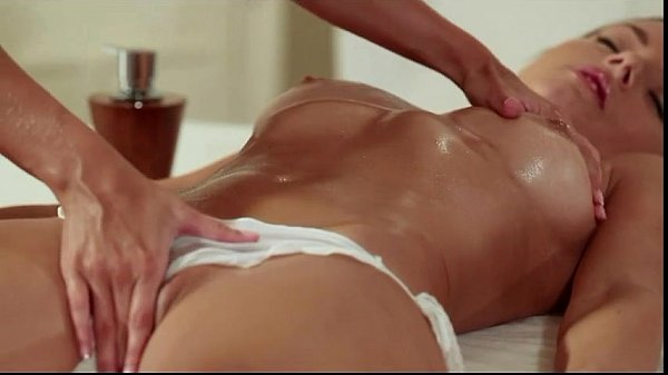 Blonde masseuse and brunette finger each other