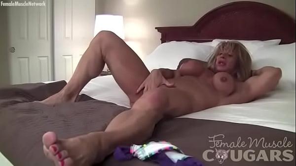 Female Bodybuilder Shows Off Her Big Clit