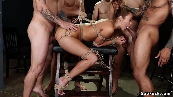 Bound slut in gangbanged on wooden horse