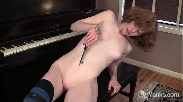 Redhead Staci Masturbating With A Knife