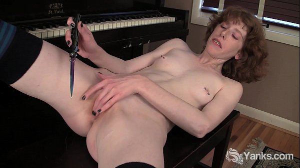 Redhead Staci Masturbating With A Knife